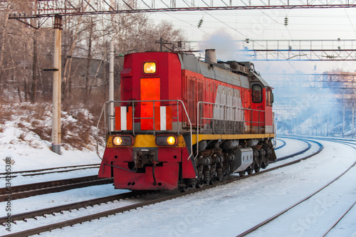 Poster Red diesel engine shunting locomotive on the railroad