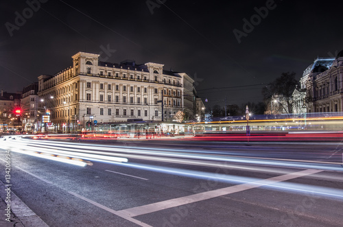 Poster Vienna, Austria, tram and car light trails on Schottentor