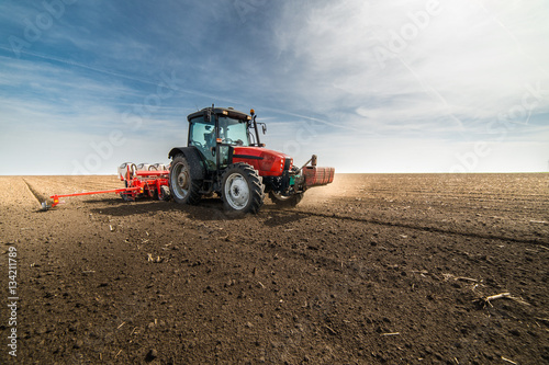 seeding crops at field Poster