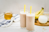Milk shake with banana, oatmeal and honey, healthy breakfast