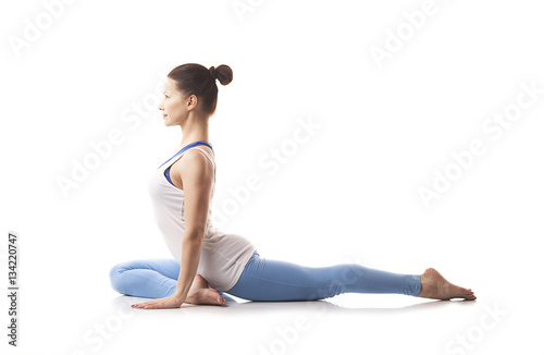Naklejka Young girl engaged in yoga. White background.