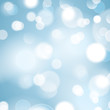 Bokeh background with circle light beams. Blurred blue background.