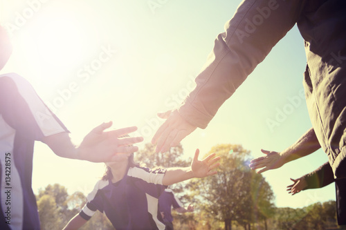 High Five line after a childs soccer game