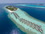 Aerial view of a tropical island in turquoise water. Luxurious over-water villas on tropical island resort maldives for holiday vacation background concept -Boost up color Processing. - 134235320