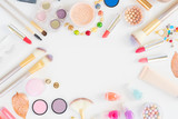 Fototapety Colorful make up and brushes flat lay frame with copy space