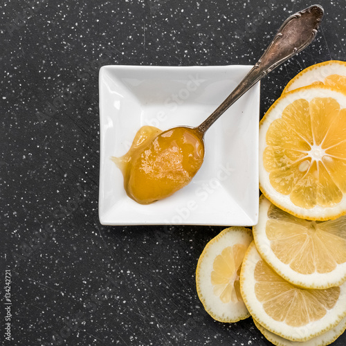 Poster Honey in spoon with lemon slices