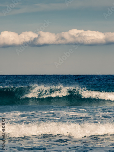 Poster Waves crashing onto beach in Corsica