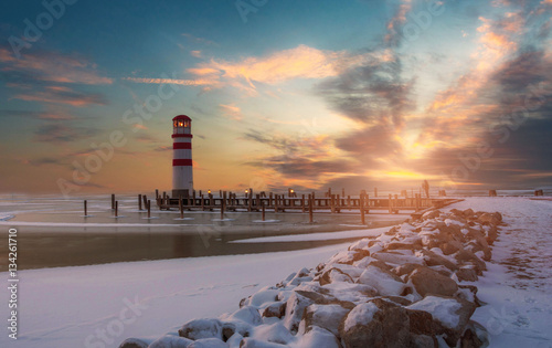 Fotobehang Pier Lighthouse neusiedl Lake at Sunset