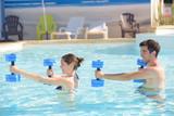 couple doing aquagym