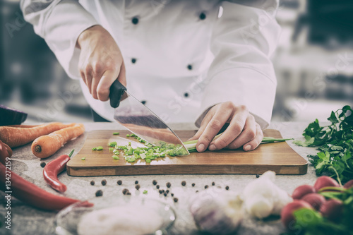 The chef slicing vegetables.