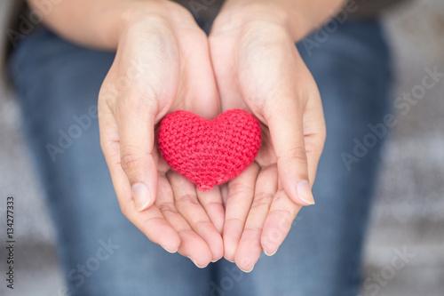 giving love. red heart in women her hand