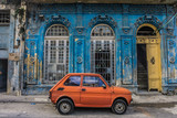 old small car in front old blue house, general travel imagery, on december 26, 2016, in La Havana, Cuba