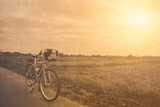 bicycle touring travel bike park at summer hot day with grunge texture vintage color tone