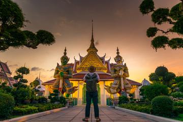 Tourist is watching landmark inside Wat Arun in Bangkok, Thailand.