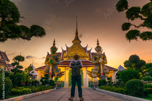Poster Tourist is watching landmark inside Wat Arun in Bangkok, Thailand