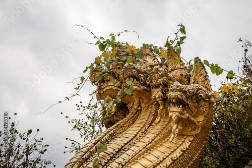 Poster Thai golden snake and dragon with many heads sculpture and statue overgrown with