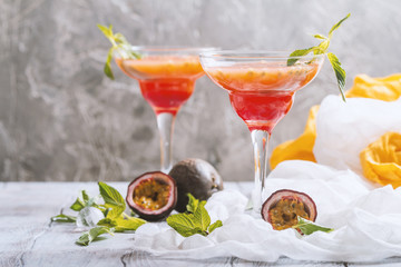 Alcoholic cocktail with fresh passion fruit