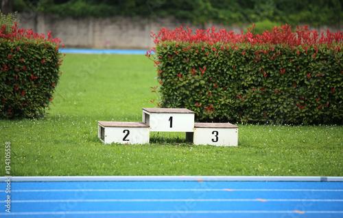 Valokuva podium of an athletics stadium with numbers one two three
