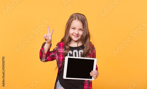 Foto Murales Happy child with tablet computer. Kid showing