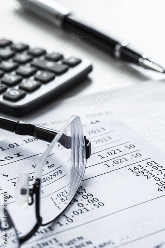Eyeglasses with calculator on table - 134324970