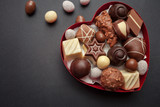 Chocolate pralines in red heart shape box
