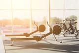 Fototapety Modern gym interior with equipment, fitness leg exercise machine