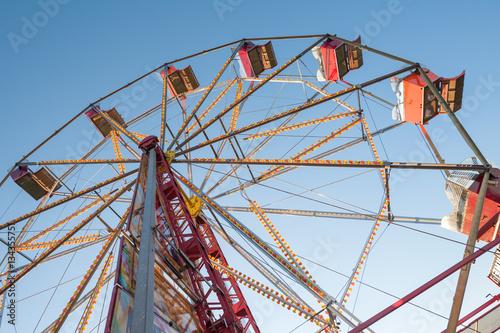 vintage Ferris wheel against a blue sky