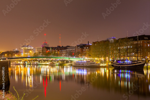 Poster Cityscape of night Bremen, Germany over the Rhein river