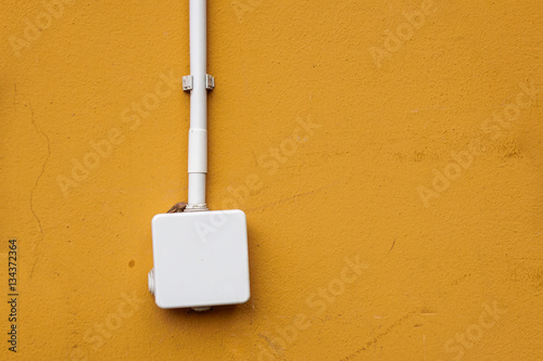 Poster electrical box for splicing  out door,on yellow wall