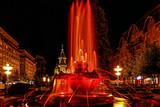 Red illuminated fountain on the Plaza Opera in Timisoara - 134374966