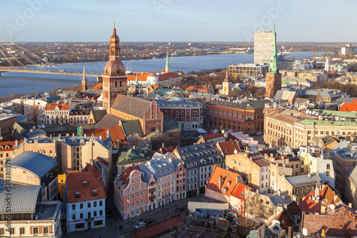 Staande foto Rome Aerial panoramic view of old town, Daugava river and modern bridge over river. Clear sunny day.