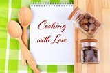 Cooking with love concept. Notebook and spices on table