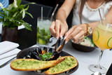 Woman eating seafood in a restaurant. - 134402546