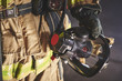 a firefighter holding an oxygen mask