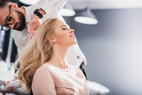 Relaxed woman is smiling at beauty studio