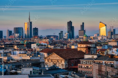 Milan skyline with modern skyscrapers in Porta Nuova business district in Milan, Italy, at sunset Poster