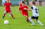 Boys kicking ball - 134452570