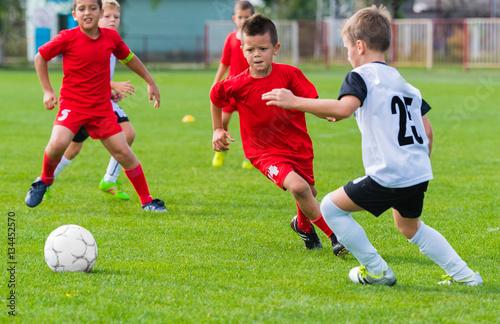 Fototapeta Boys kicking ball
