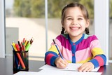 Little Girl Drawing Picture - 134455909