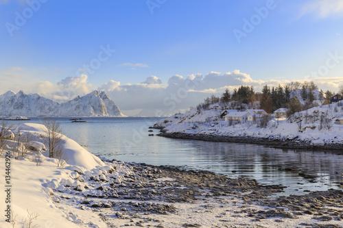 Poster Snow-covered houses at the Kjerkvagen-bay in winter, Kabelvag, Lofoten archipela