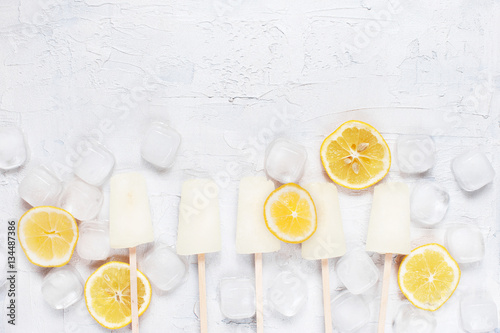 White background with lemon lollies, lemons and ice cubes Poster