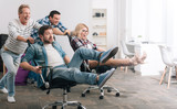 Delighted carefree people having fun in the office - 134489565