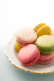 French macarons selection on a vintage plate - 134490953