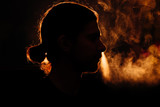 Silhouette of a smoking head in profile