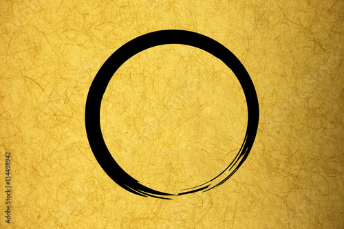 Foto op Plexiglas Stenen in het Zand Zen circle on yellow vintage rice paper texture background. Conc
