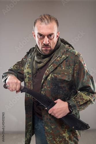 man in soldier uniform holding knife Poster