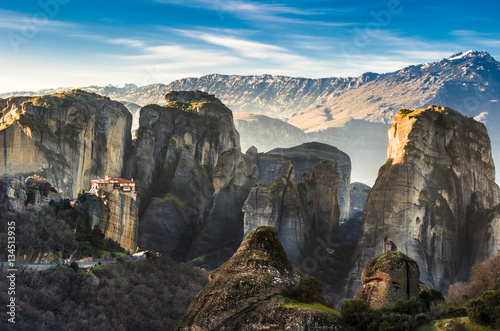 Foto op Canvas Breathtaking view of Meteora Roussanou Monastery at sunset, Greece. Geological formations of big rocks with Monasteries on top of them.