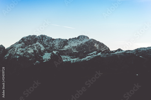 Mountain landscape silhouette at dusk in winter Poster