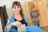 Woman voting - 134531985