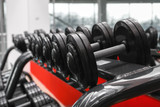Fototapety Rack with different dumbbells in gym